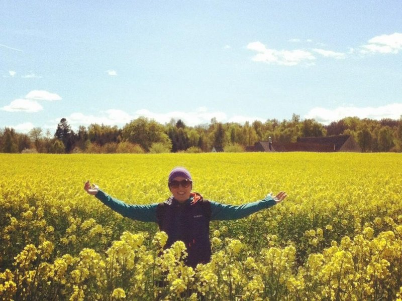First time in a bright yellow flowery rapeseed field